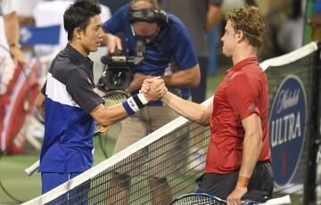 James Duckworth (R) shakes hands with Kei Nishikori after falling in the second round of the ATP Citi Open in Washington DC; Getty Images