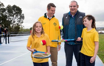 Todd Woodbridge (centre left) and Ian Goolagong (centre right) with Reservoir East Primary School students; Fiona Hamilton