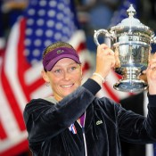 Sam holds the champion's trophy at the 2011 US Open; Getty Images