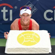 Sam Stosur is presented with a special cake to honour her 500th career singles victory at the WTA Citi Open in Washington DC; photo credit Peter Staples