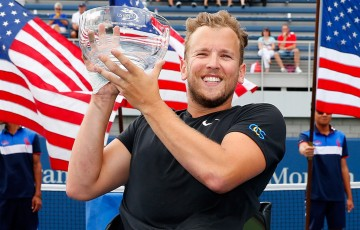 Dylan Alcott poses with the trophy after winning the US Open wheelchair quad singles tournament at Flushing Meadows; Getty Images