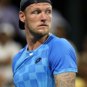Sam Groth looks on during his first-round match against Alexandr Dolgopolov; he led by two sets to one before the Ukrainian called it quits; Getty Images