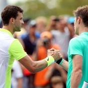 Matthew Ebden (R) shakes hands with Grigor Dimitrov after the 17th seeded Bulgarian won their first-round US Open match; Getty Images