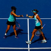Casey Dellacqua (L) and Yaroslava Shvedova in action during the US Open women's doubles final; Getty Images