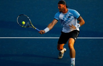 Sam Groth plays a volley in his second-round loss to Tommy Robredo at the US Open; Getty Images