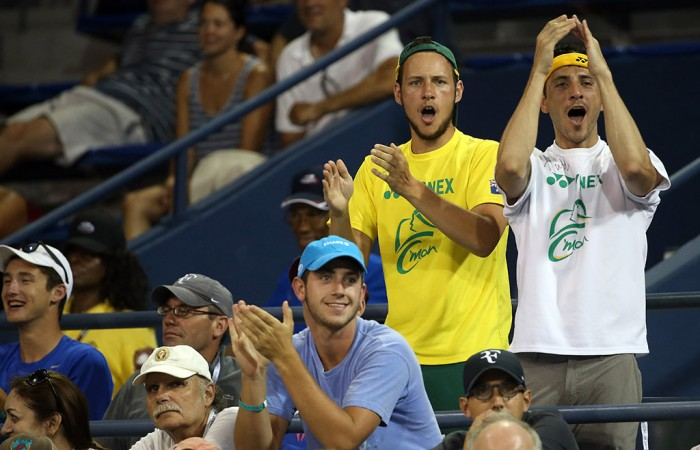 Fans enjoy the action on Grandstand in the match between Lleyton Hewitt and Bernard Tomic; Getty Images