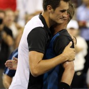 Bernard Tomic (L) and Lleyton Hewitt congratulate each other after their five-set battle at the US Open; Getty Images