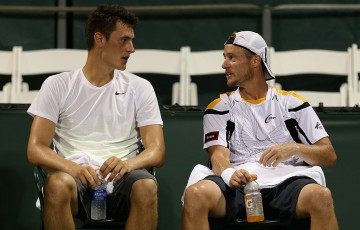 Bernard Tomic (L) and Lleyton Hewitt play doubles at the Miami Open in 2013; Getty Images