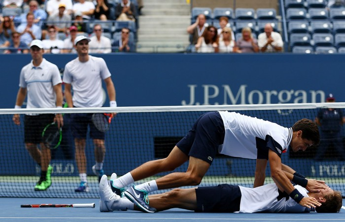 John Peers (L) and Jamie Murray watch on in the background as Frenchmen Pierre-Hugues Herbert and Nicolas Mahut celebrate their US Open men's doubles victory; Getty Images