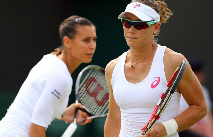 Sam Stosur (R) plays doubles with Flavia Pennetta at Wimbledon 2014; Getty Images