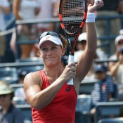 Sam Stosur waves to the crowd after beating Evgeniya Rodina in straight sets on Louis Armstrong Stadium to reach the third round of the US Open; Getty Images