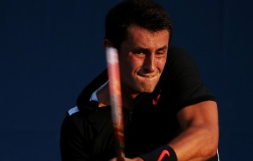 Bernard Tomic in action during his four-set victory over Damir Dzumhur in the first round of the US Open; Getty Images