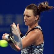 Casey Dellacqua plays a forehand in her first-round loss to Ana Ivanovic at the China Open in Beijing; Getty Images