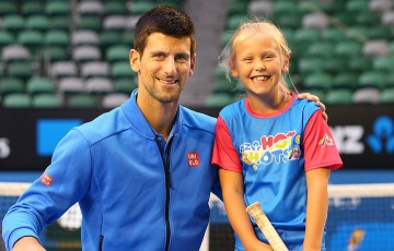 ANZ Ambassador Novak Djokovic of Serbia poses with ANZ Hot Shots winner Anna Bishop after having a hit on Rod Laver Arena at Melbourne Park during Australian Open 2015; Getty Images
