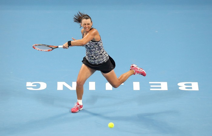 BEIJING, CHINA - OCTOBER 03:  Casey Dellacqua of Australia returns a ball against Ana Ivanovic of Serbia during the day one of the 2015 China Open at the China National Tennis Centre on October 3, 2015 in Beijing, China.  (Photo by Emmanuel Wong/Getty Images)