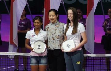 Monique Burton (R) poses with Li Na (centre) after receiving the Li Na Inspiration Award at the WTA Future Stars event in Singapore; Tennis Australia