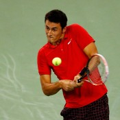 Bernard Tomic plays a backhand during his third-round victory over Richard Gasquet at the Shanghai Rolex Masters; Getty Images