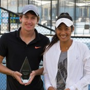 Gavin Van Peperzeel (L)  and Priscilla Hon pose with their trophies after winning the Brisbane men's and women's Pro Tour titles; Tennis Australia
