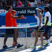 Sam Thompson and Masa Jovanovic (L) shake hands with Martina Hingis and Leander Paes after their first-round mixed doubles match at Australian Open 2015