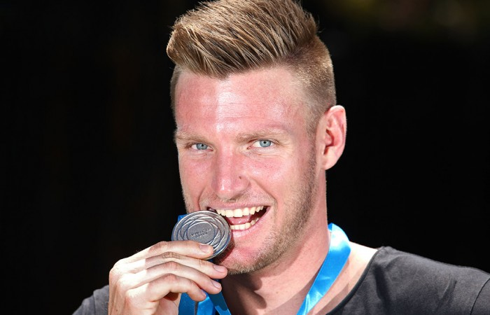 Sam Groth poses with the Newcombe Medal at Melbourne Park the day after winning the prestigious award; Getty Images