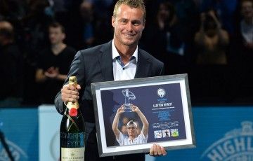 Lleyton Hewitt receives gifts from the ATP as part of an on-court ceremony at the ATP World Tour Finals recognising his career achievements; Getty Images