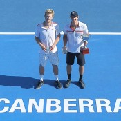 Ben Mitchell (R) and Luke Saville pose during the trophy presentation following their final at the 2015 Canberra Tennis International; Tennis Australia