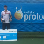 Ben Mitchell poses with his trophy after winning the 2015 Tennis Wollongong International; Tennis Australia
