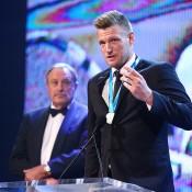 Newcombe Medal winner Sam Groth speaks as John Newcombe looks on; Getty Images