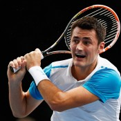 Bernard Tomic in action during his second-round loss to Stan Wawrinka at the ATP Paris Masters; Getty Images