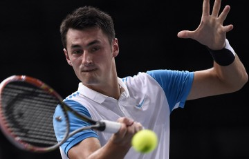 Bernard Tomic in action during his first-round victory over Fabio Fognini at the ATP Paris Masters; Getty Images