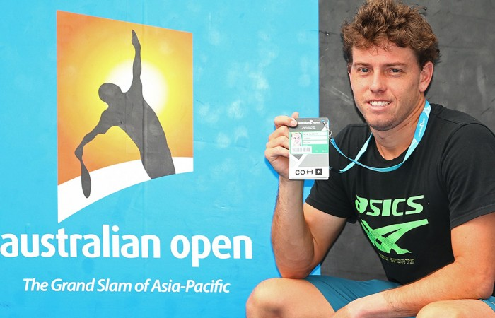 James Duckworth poses with his Australian Open player accreditation pass after winning the Australian Open 2016 Play-off; Getty Images