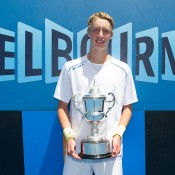 Marc Polmans poses with his trophy after winning the boys' 18/u Australian Championships title at Melbourne Park; Elizabeth Xue Bai
