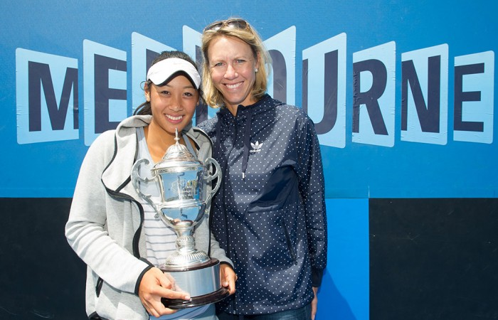 Priscilla Hon (L) poses with her trophy and Australian Fed Cup captain Alicia Molik after winning the 18/u Australian Championships; Elizabeth Xue Bai