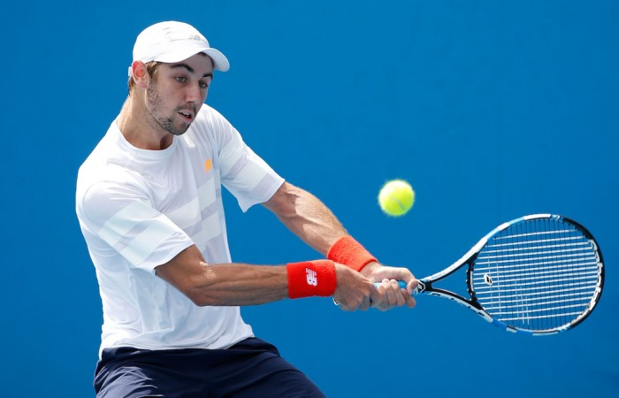 MELBOURNE, AUSTRALIA - JANUARY 19:  Jordan Thompson of Australia plays a backhand in his first round match against Thomaz Bellucci of Brazil during day two of the 2016 Australian Open at Melbourne Park on January 19, 2016 in Melbourne, Australia.  (Photo by Darrian Traynor/Getty Images)