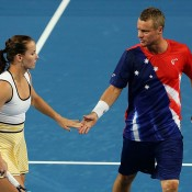 Jarmila Wolfe (L) and Lleyton Hewitt in action for Australia Gold against Czech Republic at the Hopman Cup; Getty Images