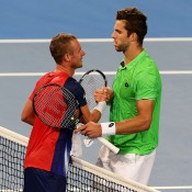 Jiri Vesely (R) shakes ands with Lleyton Hewitt after winning their singles rubber in the Czech Republic v Australia Gold Hopman Cup tie in Perth; Getty Images