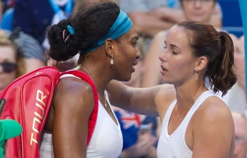 Jarmila Wolfe (R) consoles Serena Williams after the world No.1 was forced to withdraw from their Hopman Cup singles match; Getty Images