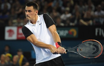 Bernard Tomic plays a backhand en route to victory over Nicolas Mahut in the first round of Brisbane International 2016; Getty Images