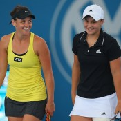 Casey Dellacqua (L) and Ash Barty in action at the Brisbane International in 2014; Getty Images
