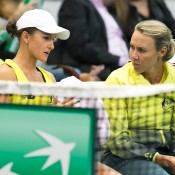 Arina Rodionova (L) consults with captain Alicia Molik during the first singles rubber of the Australia v Slovakia World Group II first round tie in Bratislava; Roman Benicky
