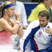 Anna Karolina Schmiedlova (L) consults with captain Matej Liptak during the first singles rubber of the Australia v Slovakia World Group II first round tie in Bratislava; Roman Benicky