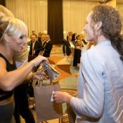 Dominika Cibulkova (L) and Sam Stosur exchange gifts at the Fed Cup team dinner in Bratislava; Tennis Australia