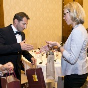 Slovak captain Matej Liptak (L) and Australian captain Alicia Molik exchange gifts at the Fed Cup team dinner in Bratislava; Tennis Australia