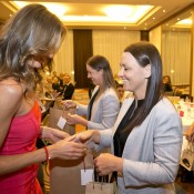 Daniela Hantuchova (L) and Casey Dellacqua exchange gifts at the Fed Cup team dinner in Bratislava; Tennis Australia