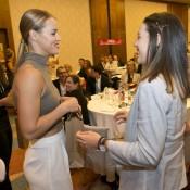 Anna Karolina Schmiedlova (L) and Kimberly Birrel exchange gifts at the Fed Cup team dinner in Bratislava; Tennis Australia