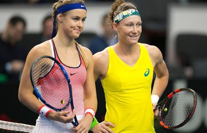 Sam Stosur (R) poses with Anna Karolina Schmiedlova ahead of their reverse singles rubber in the Australia v Slovakia Fed Cup World Group II tie in Bratislava; Roman Benicky