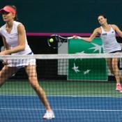 Daniela Hanuchova (L) and Jana Cepelova in action during the doubles rubber of the Australia v Slovakia Fed Cup tie in Bratislava; Roman Benicky