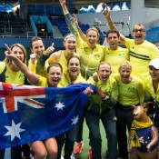 The Australian Fed Cup team celebrates victory in the Australia v Slovakia Fed Cup tie in Bratislava; Roman Benicky