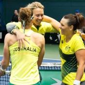 (L-R) Sam Stosur, Alicia Molik and Casey Dellacqua celebrate victory in the Australia v Slovakia Fed Cup tie in Bratislava; Roman Benicky