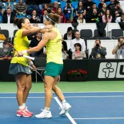 Sam Stosur (R) and Casey Dellacqua celebrate their victory in the doubles rubber of the Australia v Slovakia Fed Cup tie in Bratislava; Roman Benicky